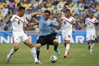 futbol_Brasil2014_Fecha01_TELAM_08_Uruguay