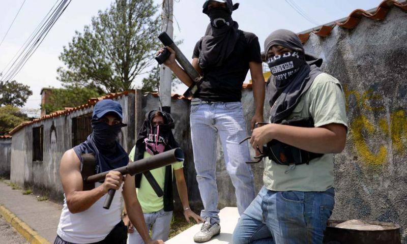 Paramilitares colombianos que actúan en Venezuela desestabilizando a la democracia.