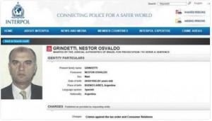 Ficha de Interpol que pide la captura de Grindetti.