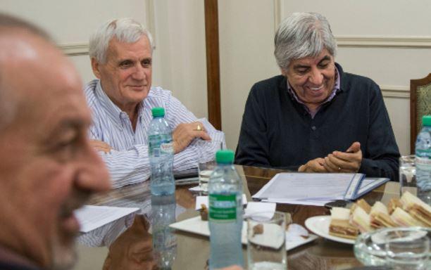 Yasky (CTA), Caló (CGT), Moyano (CGT Moyano) en la reunión que compartieron con Micheli (CTA Autónoma) y Barrionuevo (CGT Azul y Blanca) preparan el acto del 29 de abril.