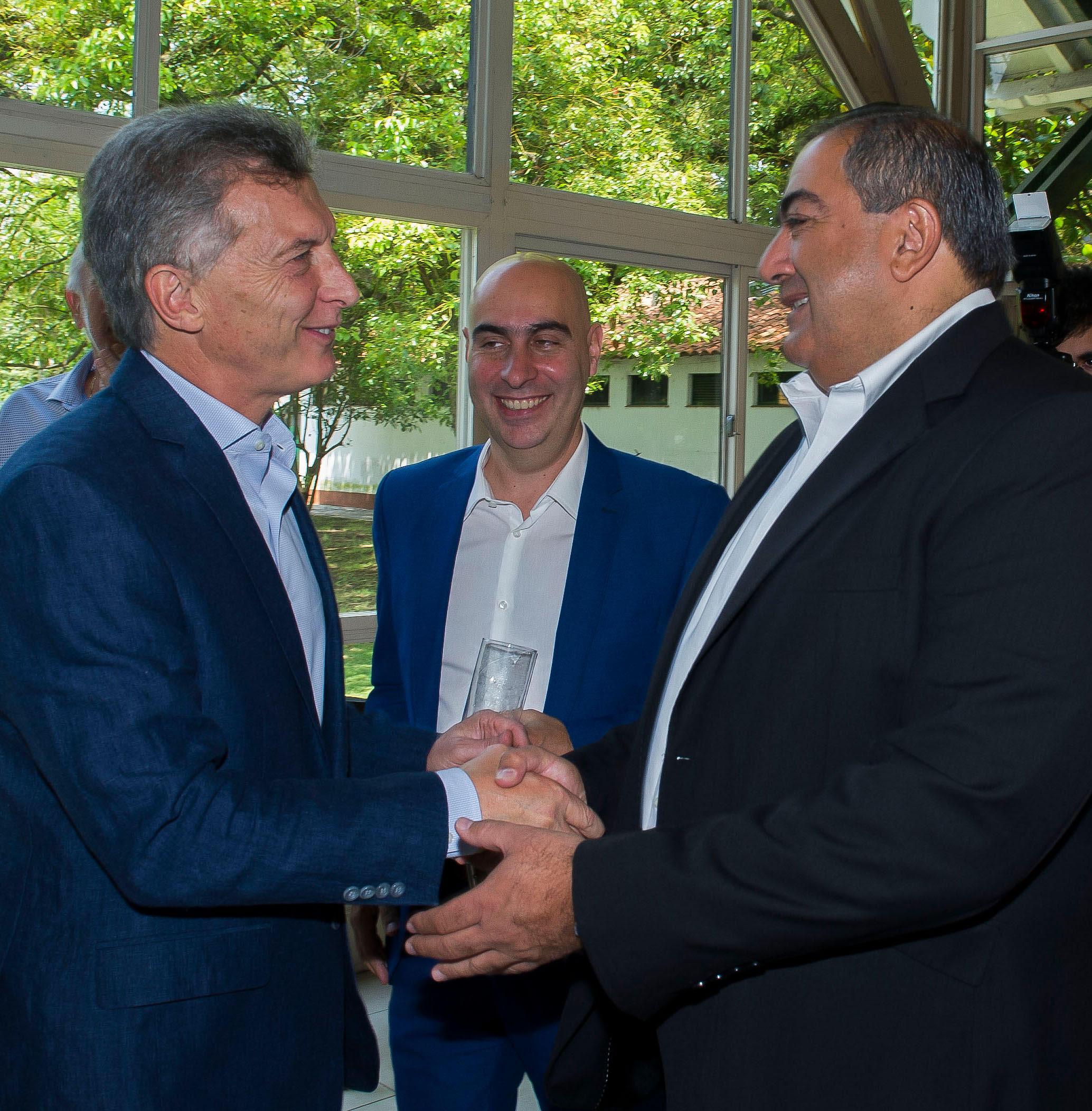 Macri y Daer, titular de la CGT.